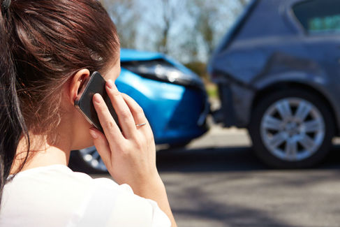 (woman calling on phone after an accident)